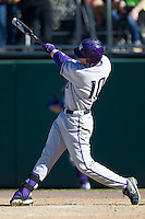 Washington Huskies outfielder Brian Wolfe (10) swings the bat during the NCAA season opening baseball game against the Air Force Falcons on February 14, 2014 at Bobcat Ballpark in San Marcos, Texas. Air Force defeated Washington 14-9. (Andrew Woolley/Four Seam Images)