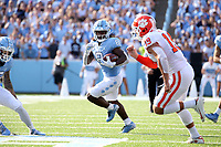 CHAPEL HILL, NC - SEPTEMBER 28: Michael Carter #8 of the University of North Carolina runs the ball during a game between Clemson University and University of North Carolina at Kenan Memorial Stadium on September 28, 2019 in Chapel Hill, North Carolina.