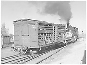 RGS stock car #7454 being switched by #454.  Note dual gauge track and the transition flat car.<br /> RGS  Montrose, CO  Taken by Richardson, Robert W. - 9/26/1951