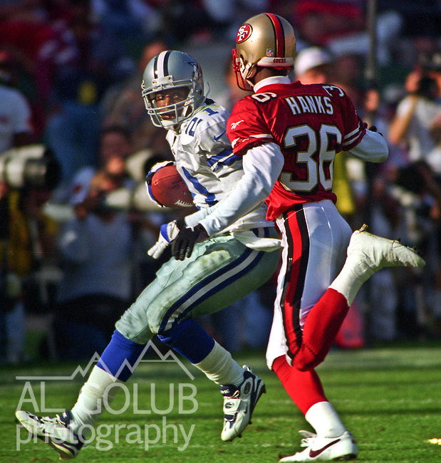 San Francisco 49ers vs. Dallas Cowboys at Candlestick Park Sunday, November 10, 1996.  Cowboys beat 49ers  20-17.  San Francisco 49ers defensive back Merton Hanks (36) catches up with Dallas Cowboys wide receiver Deion Sanders (21).