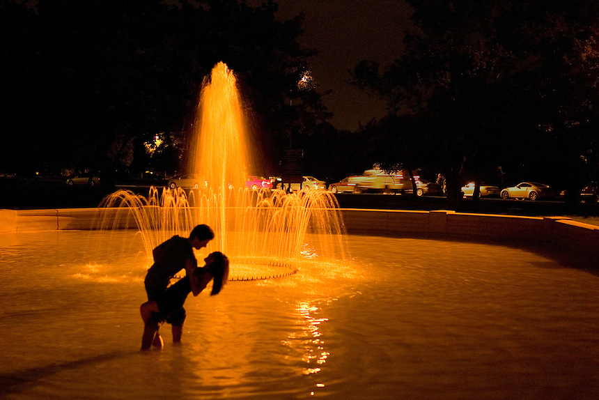 Tango dancers Paul Vladimirsky, left, and Cassandra Kagiyama, of Phoenix, tango in a fountain at Denver's Cheesman Park during the 7th Annual Denver Memorial Day Tango Festival. The Arizona State University students stepped into the pool to comfort feet tired from several nights of dancing at the festival. (Kevin Moloney for the New York Times)