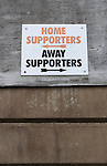 Altrincham 2 Worcester City 0, 23/03/2013. Moss Lane, Blue Square Bet North. A sign reading 'home supporters and away supporters' on the outside wall of the stadium before the Blue Square Bet North fixture between Altrincham and Worcester City at Moss Lane, Altrincham. The home team won the match 2-0 watched by 777 spectators on a day when most non-League football in England was cancelled due to adverse weather. Altrincham were historically one of the major English non-League teams but have never been promoted to the Football League. Photo by Colin McPherson.