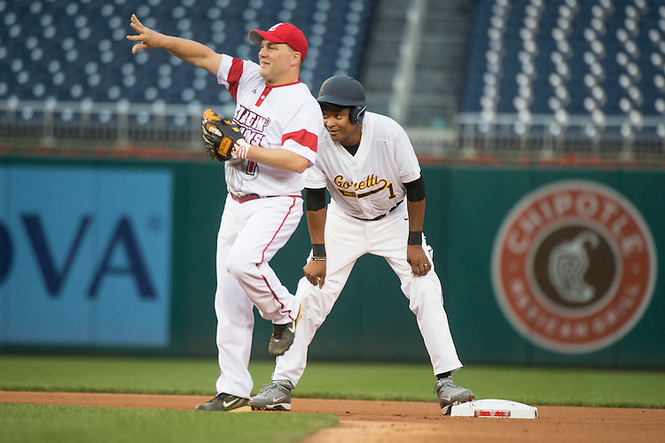 UNITED STATES - JUNE 23: Reps. Cedric Richmond, D-La., right, and Steve Scalise, R-La., play during the Republicans' 8-7 victory in the 55th Congressional Baseball Game at Nationals Park, June 23, 2016. (Photo By Tom Williams/CQ Roll Call)