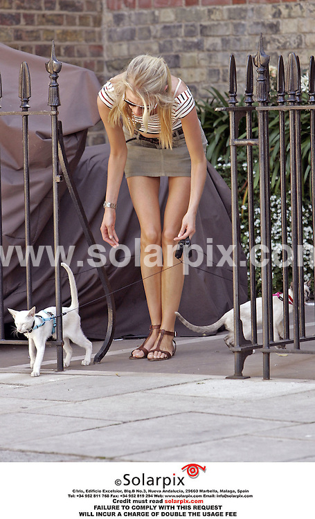 "EXCLUSIVE PICTURES FROM SOLARPIX.COM.*MUST AGREE FEE BEFORE PUBLICATION*.*UK PAPERS ONLY*MUST CREDIT SOLARPIX.COM OR DOUBLE USAGE FEE CHARGED*.Donna Air found it hard to let her cats go, when she tried to drop them off at a cat sitter so she could nip off for a weekend break without them. She was obviously used to taking them places with her, as both cats were equipped with harnesses and leads. After dropping off the Siamese duo, she sat down on a pavement and looked close to tears as she spoke to a friend on her mobile phone. An onlooker near Harrods department store in Knightsbridge said, ""It all looked rather bizarre. I have never known anyone to take their cats for a walk like that. Maybe if she had a couple of dogs, they would pull her over!"".REF: 2485 RMN"