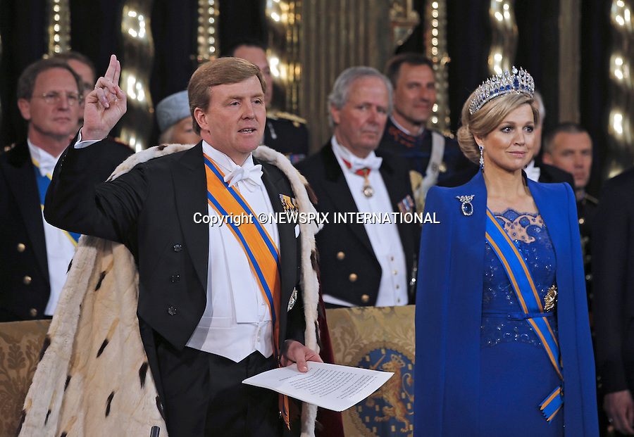 """30.04.2013; Amsterdam: KING WILLEM-ALEXANDER AND QUEEN MAXIMA.King Willem-Alexander takes the oath next to his wife Queen Maxima at Nieuwe Kerk, Amsterdam, The Netherlands, during the inauguration ceremony..Mandatory Credit Photos: ©Dejong/NEWSPIX INTERNATIONAL..**ALL FEES PAYABLE TO: """"NEWSPIX INTERNATIONAL""""**..PHOTO CREDIT MANDATORY!!: NEWSPIX INTERNATIONAL(Failure to credit will incur a surcharge of 100% of reproduction fees)..IMMEDIATE CONFIRMATION OF USAGE REQUIRED:.Newspix International, 31 Chinnery Hill, Bishop's Stortford, ENGLAND CM23 3PS.Tel:+441279 324672  ; Fax: +441279656877.Mobile:  0777568 1153.e-mail: info@newspixinternational.co.uk"""