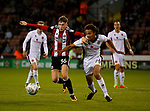David Brooks of Sheffield Utd tussles with Kory Roberts of Walsall during the Carabao Cup First Round match at Bramall Lane Stadium, Sheffield. Picture date: August 9th 2017. Pic credit should read: Simon Bellis/Sportimage