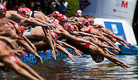 05 JUN 2010 - MADRID, ESP - Competitors dive into the water at the start of the Madrid round of the womens ITU World Championship Series triathlon which also served as the first chance to win points towards qualification for the London 2012 Olympic Games .(PHOTO (C) NIGEL FARROW)