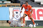 14 April 2012: Carolina's John Krause (27) gets past Atlanta's Nico Colaluca (14). The Carolina RailHawks played the Atlanta Silverbacks to a 4-4 tie at WakeMed Soccer Stadium in Cary, NC in a 2012 North American Soccer League (NASL) regular season game.