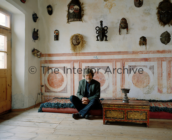Mountaineer and explorer, Reinhold Messner, in the hallway of his summer home, Castle Juval