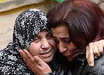 Relatives of Palestinian Baseem Salah, 38-year-old mourn during his funeral in the West Bank city of Nablus on Dec. 30, 2015. Salah was killed Nov. 30 after an attack left an Israeli police officer wounded in Jerusalem's Old City. Since a wave of unrest swept the occupied Palestinian territory at the beginning of October, Israel has routinely held the bodies of Palestinians it says were attempting to attack Israelis. Photo by Nedal Eshtayah