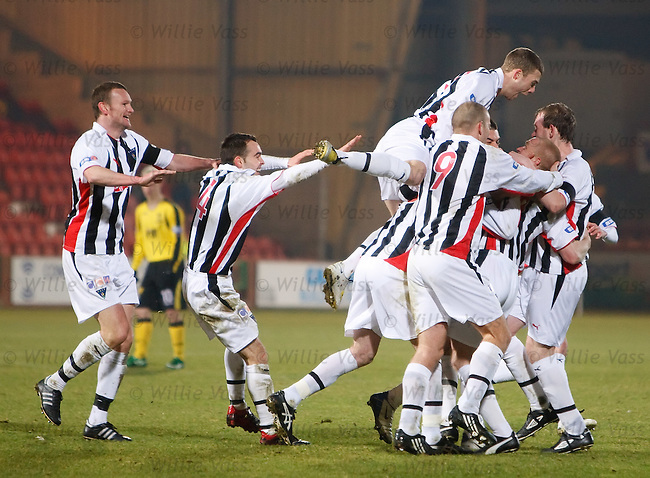 Pars goalscorer Greg Shields is swamped as Dunfermline celebrate