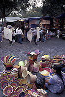An indigenous woman selling her baskets at the Bazar Sabado, the Saturday bazaar held in San Angel, a suburb of Mexico City