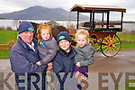 Jarvey Pat Joy, Killarney Horse and Carriage company, pictured with James and Maurice Joy and Katie Healy with his covered wagon in Killarney.