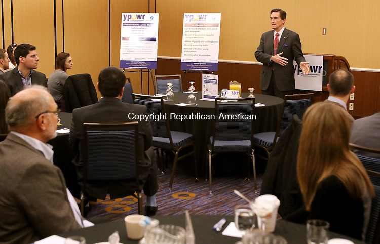 WATERBURY CT. 22 January 2016-012216SV02-James C. Smith, chairman and CEO of Webster Bank, speaks during the Young Professionals of Waterbury Region meeting in Waterbury Friday. The YPOWR meeting was  a Waterbury Regional Chamber event.<br /> Steven Valenti Republican-American