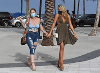 FORT LAUDERDALE, FL - JUNE 28: Two Women are seen wearing masks on Fort Lauderdale Beach as South Florida beaches are to close for July Fourth weekend, Florida reports another record spike in coronavirus cases, Floridaís Covid-19 surge shows the state's reopening plan is not working on June 28, 2020 in Fort Lauderdale Beach, Florida. Credit: mpi04/MediaPunch