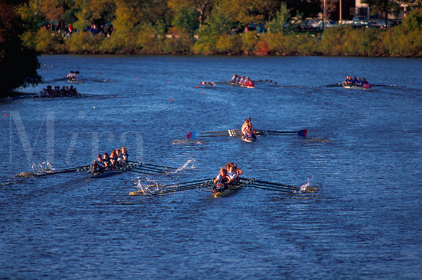 Several boats in competition at the Head of the Charles Regatta. Cambridge, Massachusetts.
