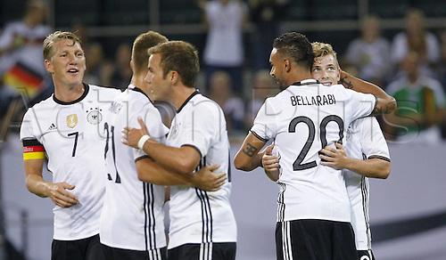 31.08.2016 Moenchengladbach, Germany. International football freindly. Germany versus Finland. Max Meyer of Germany (R) celebrates scoring the 1:0 goal with Karim Bellarabi and Bastian Schweinsteiger (L)
