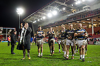 The Bath Rugby team acknowledge their supporters in the crowd after the match. Aviva Premiership match, between Gloucester Rugby and Bath Rugby on March 26, 2016 at Kingsholm Stadium in Gloucester, England. Photo by: Patrick Khachfe / Onside Images
