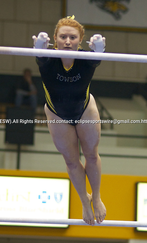 Towson University's Alexa Davis competes on the uneven bars during the Shelli Calloway Memorial Gymnastics Invitational at Towson University in Towson, Maryland.
