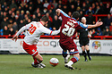 Chris Beardsley of Stevenage's shot is blocked by Max Power of Tranmere. - Stevenage v Tranmere Rovers - npower League 1 - Lamex Stadium, Stevenage - 17th December 2011  .© Kevin Coleman 2011 ... ....  ...  . .