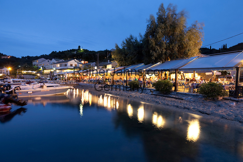 Greece, Corfu, Agios Stefanos: Harbour side restaurants at night