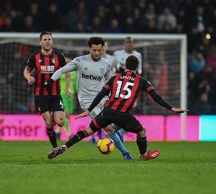 West Ham United's Felipe Anderson (centre) under pressure from Bournemouth's Adam Smith (right) <br /> <br /> Photographer David Horton/CameraSport<br /> <br /> The Premier League - Bournemouth v West Ham United - Saturday 19 January 2019 - Vitality Stadium - Bournemouth<br /> <br /> World Copyright &copy; 2019 CameraSport. All rights reserved. 43 Linden Ave. Countesthorpe. Leicester. England. LE8 5PG - Tel: +44 (0) 116 277 4147 - admin@camerasport.com - www.camerasport.com
