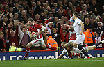 Alex Cuthbert leaves the English defence trailing to score his second try of the match in the corner..2013 RBS 6 Nations Championship.Wales v England.Millennium Stadium.16.03.13.Credit: Steve Pope- Sportingwales