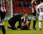 James Hanson of Sheffield Utd goes down injured during the Carabao Cup First Round match at Bramall Lane Stadium, Sheffield. Picture date: August 9th 2017. Pic credit should read: Simon Bellis/Sportimage