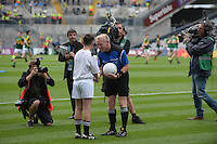 Micheal Keane, son of trainer Peter brings the ball to the referee for the All-Ireland Minor Fiitball Final.<br /> <br /> Kerry win the 2016 All-Ireland Minor Football Championship.<br /> Photo Don MacMonagle