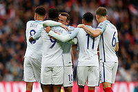 Wayne Rooney (Manchester United) of England (3rd left) congratulates Daniel Sturridge (Liverpool) of England on his opening goal during the FIFA World Cup qualifying match between England and Malta at Wembley Stadium, London, England on 8 October 2016. Photo by David Horn / PRiME Media Images.