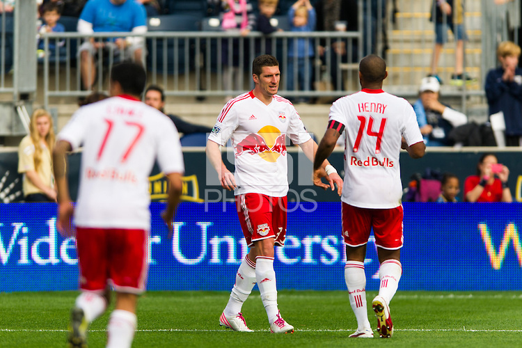 Kenny Cooper (33) celebrates scoring with Thierry Henry (14). The New York Red Bulls defeated the Philadelphia Union 3-0 during a Major League Soccer (MLS) match at PPL Park in Chester, PA, on October 27, 2012.