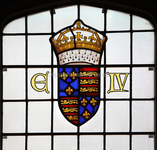 Stained glass window, All Hallows by the Tower, London, UK, founded 675 AD, by The Saxon Abbey of Barking. This stained glass window by M C Farrer Bell, c. 1956, shows the coat of arms of King Edward IV, 1442-83, who established chapel here in middle of 15th century. His arms contain fleur de lys of France representing the Trinity. Picture by Manuel Cohen