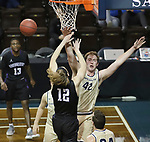 SIOUX FALLS, SD - MARCH 9:  Sam Vander Sluis #42 of Cornerstone blocks the shot of Brent Smith #12 of Southwestern at the 2018 NAIA DII Men's Basketball Championship at the Sanford Pentagon in Sioux Falls. (Photo by Dick Carlson/Inertia)
