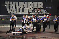 Jun. 15, 2012; Bristol, TN, USA: NHRA crew members for top fuel dragster driver Antron Brown during qualifying for the Thunder Valley Nationals at Bristol Dragway. Mandatory Credit: Mark J. Rebilas-