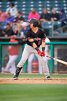 Dom Nunez (5) of the Albuquerque Isotopes bats against the Salt Lake Bees at Smith's Ballpark on April 24, 2019 in Salt Lake City, Utah. The Isotopes defeated the Bees 5-4. (Stephen Smith/Four Seam Images)