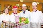 Norann O'Connor, Oliver Falvey, Dan O'Regan and Tom Garvey display some of the beautiful hams on offer at the Garvey's Super Valu Castleisland food fair on Friday