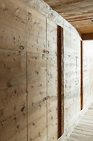 Detail of a built-in wooden wardrobe in the chalet's master bedroom