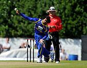 Cricket - ODI Summer Tri-Series - Scotland V Sri Lanka at Grange CC - Edinburgh - Sri Lanka opening bowler Lasith Malinga send down one of his unique deliveries past Umpire Marais Erasmus and going on to decimate the Scotland batting line-up with figures of 5 for 30 - Picture by Donald MacLeod - 13.07.11 - 07702 319 738 - www.donald-macleod.com
