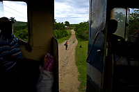 IZNAGA, CUBA - MAY 10: Cuban passenger stand as a man walks during a trip from Iznaga to Trinidad on May 10, 2018. in Cuba. Ferrocarriles de Cuba, is one of the oldest railroad around world, having opened its first route in 1837 with at least 17-mile long. Now the railway probably could cover more than 2,600 miles along the Island.  (Photo by Eliana Aponte/VIEWpress)