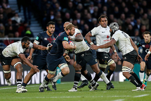 19.11.2016. Twickenham, London, England. Autumn International Rugby. England versus Fiji.  Chris Robshaw of England on the ball as Elliot Daly of England makes the tackle.   Final score: England 58-15 Fiji.
