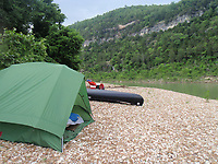Some campers consider a 4-person tent more of a 2-person tent and a 4-person tent more suitable for two people. A 4-person tent is seen her pitched beside the Buffalo National River during a float of the whole river in 2009.<br />