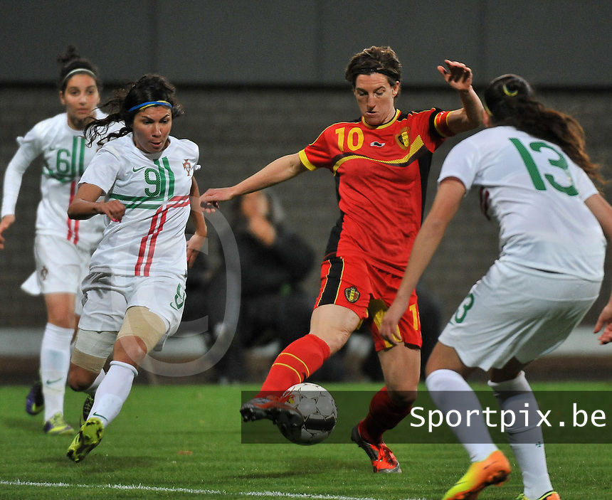 20131031 - ANTWERPEN , BELGIUM : Belgian Aline Zeler (10) pictured with Portugese Ana Borges (9)  during the female soccer match between Belgium and Portugal , on the fourth matchday in group 5 of the UEFA qualifying round to the FIFA Women World Cup in Canada 2015 at Het Kiel stadium , Antwerp . Thursday 31st October 2013. PHOTO DAVID CATRY