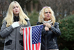 WATERBURY CT. 31 December 2018-123118SV03-From left, Kendelle Pitts and her mom, Bambi Marangio-Pitts both of Waterbury watch as the hearse carrying Zeqir &quot;Ziggy the Flag Man&quot; Berisha enters Calvary Cemetery in Waterbury Monday.<br /> Steven Valenti Republican-American