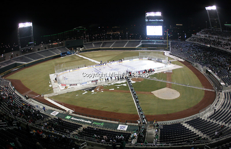 North Dakota heads to the ice for the second period. North Dakota beat Nebraska-Omaha 5-2 in the outdoor game at TD Ameritrade Park on Saturday, Feb. 9, 2013. (Photo by Michelle Bishop)