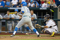 UCLA shortstop Pat Valaika (10) squares to bunt during Game 1 of the 2013 Men's College World Series Finals against the Mississippi State Bulldogs on June 24, 2013 at TD Ameritrade Park in Omaha, Nebraska. The Bruins defeated the Bulldogs 3-1, taking a 1-0 lead in the best of 3 series. (Andrew Woolley/Four Seam Images)