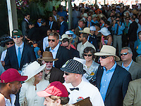 Scenes from the infield and grandstand on Preakness Day at Pimlico Race Course on May 19, 2012