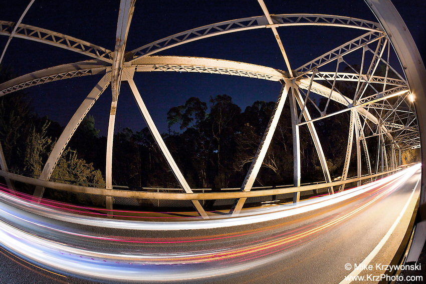 A long-exposure view of the Karsten Thot Bridge at night in Wahiawa, O'ahu