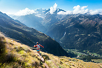 Trail running in Verbier, with a view of the Grand Combin, on day one of the Via Valais, a multi-day running tour connecting Verbier and Zermatt, Switzerland.
