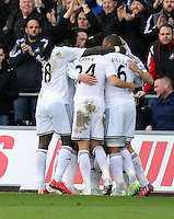SWANSEA, WALES - FEBRUARY 21: Ki Sung Yueng of Swansea celebrates his equaliser with team mates during the Barclays Premier League match between Swansea City and Manchester United at Liberty Stadium on February 21, 2015 in Swansea, Wales.
