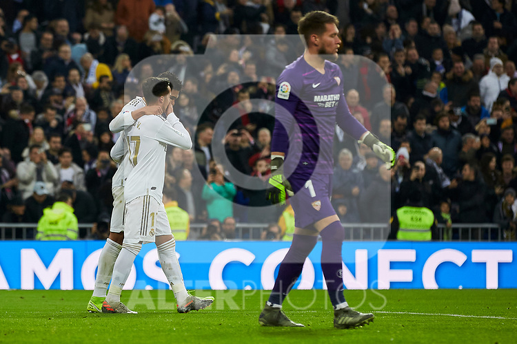 Lucas Vazquez and Carlos Henrique Casemiro of Real Madrid celebrate goal during La Liga match between Real Madrid and Sevilla FC at Santiago Bernabeu Stadium in Madrid, Spain. January 18, 2020. (ALTERPHOTOS/A. Perez Meca)